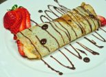 Receta de crepes de chocolate y fresas.