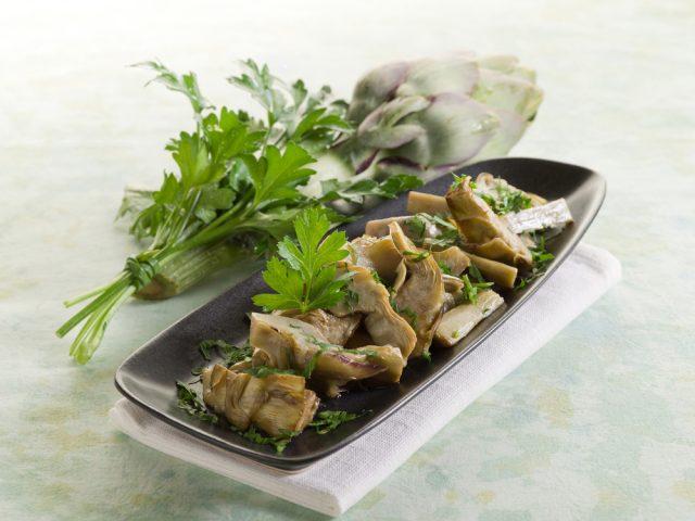 Receta de alcachofas con jamón y champiñones